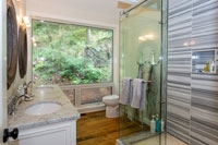 Washroom Accented with Marble Tile & Glass Shower